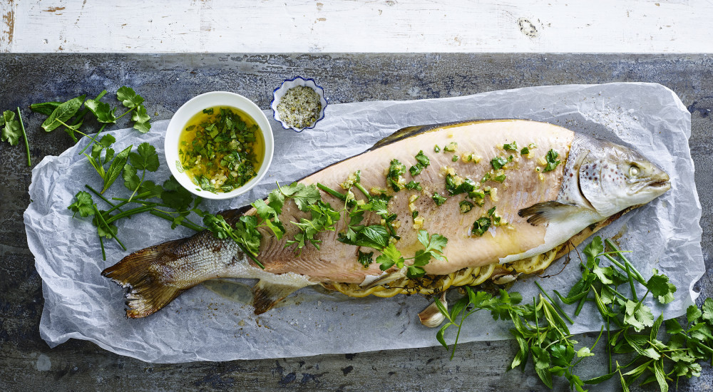 Whole baked salmon with preserved lemon and herbs
