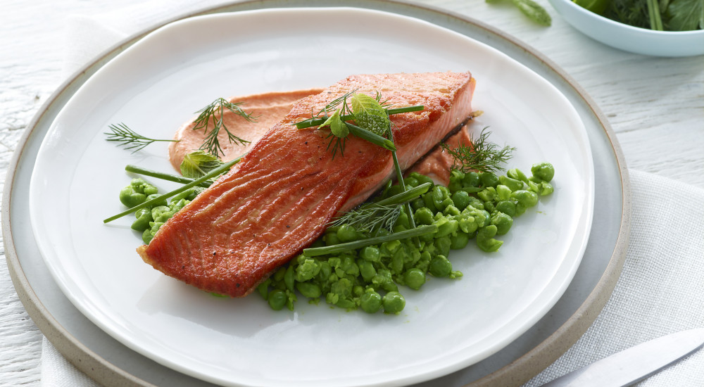Roasted (pan fried) ocean trout with crushed peas and capsicum mayonnaise
